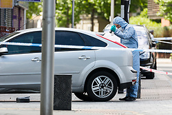 © Licensed to London News Pictures. 27/05/2019. London, UK.  A Police forensic officer at the crime scene in St Paul's Way, Mile End in Tower Hamlets, where a 23 year old man was stabbed multiple times yesterday, 26th May and died overnight in hospital.  Photo credit: Vickie Flores/LNP