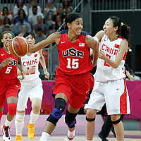 05 August 2012: USA Candace Parker is fouled by  during 114-66 Team USA victory over Team China, during the women's basketball preliminary, at the Basketball Arena, in London, Great Britain.