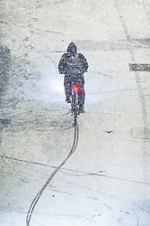 © Licensed to London News Pictures. 31/01/2019. London, UK. A man cycles on the snow covered streets of Wembley. Photo credit: Ray Tang/LNP