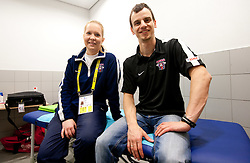 Physiotherapists of Slovenian team Manca Marc and Urban Komac in wardrobe prior to the ice-hockey match between Slovenia and Latvia of IIHF 2011 World Championship Slovakia, on May 5, 2011 in Orange Arena, Bratislava, Slovakia.  (Photo By Vid Ponikvar / Sportida.com)