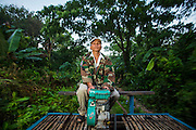 29 JUNE 2013 - BATTAMBANG, CAMBODIA:  A bamboo train on the tracks to O Sra Lav, a small village southeast of Battambang. The bamboo train, called a norry (nori) in Khmer is a 3m-long wood frame, covered lengthwise with slats made of ultra-light bamboo, that rests on two barbell-like bogies, the aft one connected by fan belts to a 6HP gasoline engine. The train runs on tracks originally laid by the French when Cambodia was a French colony. Years of war and neglect have made the tracks unsafe for regular trains.  Cambodians put 10 or 15 people on each one or up to three tonnes of rice and supplies. They cruise at about 15km/h. The Bamboo Train is very popular with tourists and now most of the trains around Battambang will only take tourists, who will pay a lot more than Cambodians can, to ride the train.       PHOTO BY JACK KURTZ