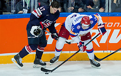 Torey Krug of USA lost his helmet against Viktor Tikhonov of Russia during Ice Hockey match between USA and Russia at Semifinals of 2015 IIHF World Championship, on May 16, 2015 in O2 Arena, Prague, Czech Republic. Photo by Vid Ponikvar / Sportida