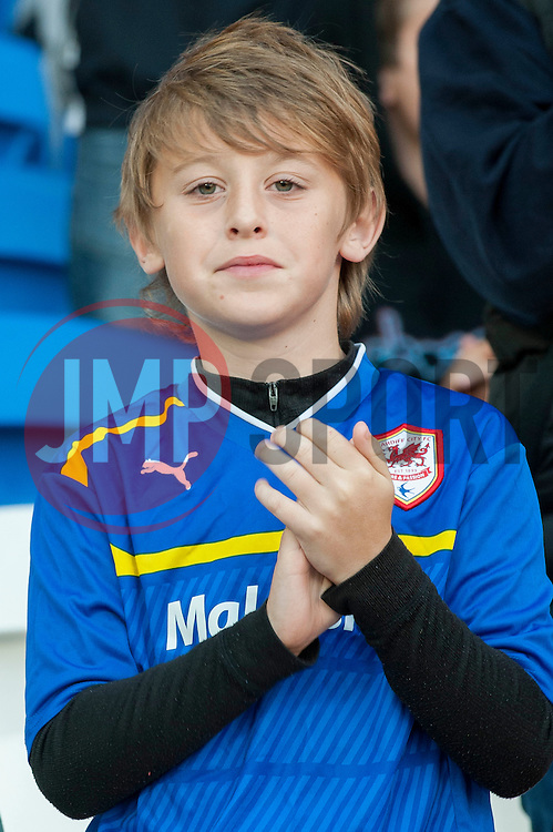 A young Cardiff City fan - Photo mandatory by-line: Dougie Allward/JMP - Mobile: 07966 386802 19/08/2014 - SPORT - FOOTBALL - Cardiff - Cardiff City Stadium - Cardiff City v Wigan Athletic - Sky Bet Championship