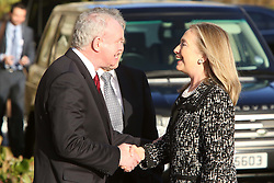 US Secretary of State Hillary Clinton smiles as she is greeted by the Northern Ireland First Minister Peter Robinson (C) and the Deputy First Minister Martin McGuinness upon her arrival at Stormont Castle, East Belfast, Northern Ireland, December 7, 2012. Photo by i-Images.