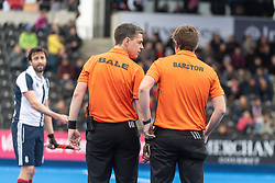 Umpires Bruce Bale and David Barstow confer. Wimbledon v Hampstead & Westminster - Men's Hockey League Finals, Lee Valley Hockey & Tennis Centre, London, UK on 28 April 2018. Photo: Simon Parker