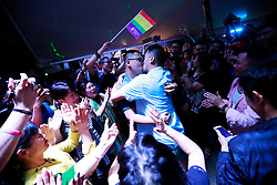 A gay couple kisses during a party after a LGBT (lesbian, gay, bisexual and transgender) mass wedding organised by the Parents and Friends of Lesbians and Gays (PFLAG) China organisation on a cruise in open seas on route to Sasebo, Japan, 15 June 2017. About 800 members of the Chinese LGBT (lesbian, gay, bisexual and transgender) community and their parents spent four days on a cruise trip organised by Parents and Friends of Lesbians and Gays (PFLAG) China, a grassroots non-government organisation, celebrating the 10th anniversary of the organisation. It aims to promote coexistence among homosexuals and their families.