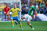 Paris, France - 2016 June 13: (L) Oscar Lewicki of Sweden fights for the ball with (R) Glenn Whelan of Republic of Ireland while Sweden v Ireland match during Soccer European Championships UEFA EURO 2016 at Stade de France on June 13, 2016 in Paris, France.<br /> <br /> Adam Nurkiewicz declares that he has no rights to the image of people at the photographs of his authorship.<br /> <br /> Picture also available in RAW (NEF) or TIFF format on special request.<br /> <br /> Any editorial, commercial or promotional use requires written permission from the author of image.<br /> <br /> Mandatory credit:<br /> Photo by © Adam Nurkiewicz