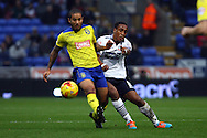 Sean Scannell of Huddersfield Town tackles Neil Danns of Bolton Wanderers (r). Skybet football league championship match, Bolton Wanderers v Huddersfield Town at the Macron stadium in Bolton, Lancs on Saturday 29th November 2014.<br /> pic by Chris Stading, Andrew Orchard sports photography.