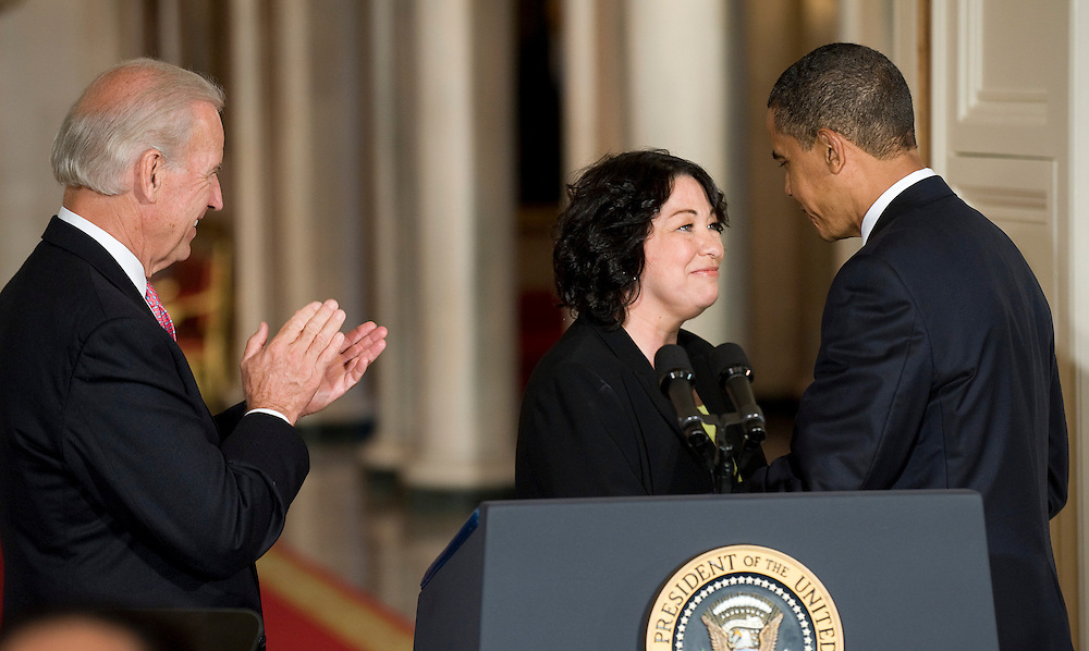 US President Barack Obama (R) and Vice President Joseph Biden (L) congratulate Obama's Supreme Court nominee Sonia Sotomayor, a 54-year-old appeals court judge from New York, in the East Room of the White House in Washington, DC, USA on 26 May 2009. If confirmed, Sotomayor will succeed retiring Associate Justice David Souter and would become the first Hispanic-American to serve on the Supreme Court.