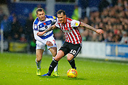 Brentford's Midfielder Josh McEachran & Rangers Midfielder Luke Freeman during the EFL Sky Bet Championship match between Queens Park Rangers and Brentford at the Loftus Road Stadium, London, England on 10 November 2018.