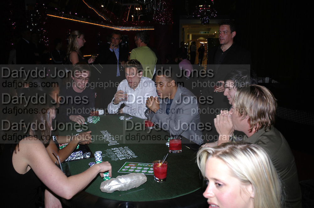 James Cracknell and John Barnes. PARTYPOKER.COM masterclass hosted by poker author Tony Holden. Ultra Lounge, Selfridges. 11 May 2005. ONE TIME USE ONLY - DO NOT ARCHIVE  © Copyright Photograph by Dafydd Jones 66 Stockwell Park Rd. London SW9 0DA Tel 020 7733 0108 www.dafjones.com