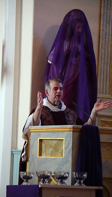 apl030117c/ASECTION/030117/pierre-louis/JOURNAL <br /> San Felipe de Neri Catholic Church Pastor Rev. Andrew Pavlak,, pronounces his homily during the 7:00AM Mass at the Old Town church.A statue of Jesus is covered with a purple veil as  Ash Wednesday marks the beginning of Lent .Photographed  on Wednesday March 1, 2017. .Adolphe Pierre-Louis/JOURNAL