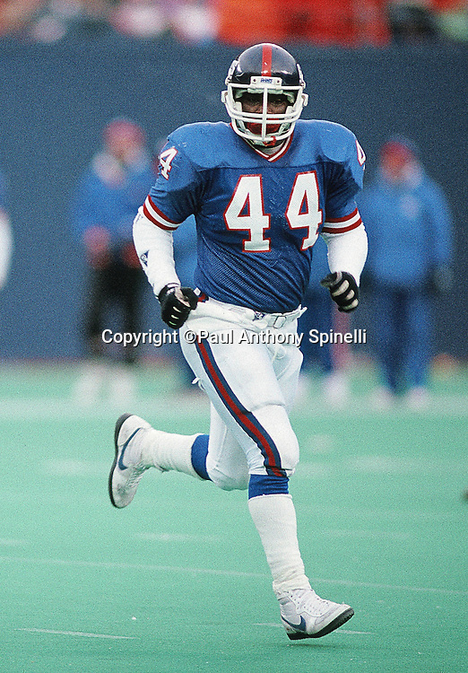 New York Giants fullback Maurice Carthon (44) goes in motion during the NFL football game against the Los Angeles Raiders on Dec. 24, 1989 in East Rutherford, N.J. The Giants won the game 34-17. (©Paul Anthony Spinelli)