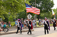 Crowds lined the streets of downtown Laconia as the Knights of Columbus march during the annual Memorial Day parade Sunday morning.  (Karen Bobotas/for the Laconia Daily Sun)