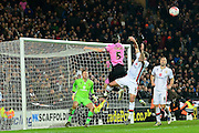 Northampton Town defender Zander Diamond leaps highest  during the The FA Cup Third Round Replay match between Milton Keynes Dons and Northampton Town at stadium:mk, Milton Keynes, England on 19 January 2016. Photo by Dennis Goodwin.