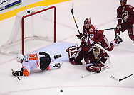 Dec. 3 2011; Glendale, AZ, USA; Phoenix Coyotes goalie Jason LaBarbera (1) falls to the ice after a collision with Philadelphia Flyers forward Scott Hartnell (19) as Phoenix Coyotes defensemen Oliver Ekman-Larsson (23) also trips over Phoenix Coyotes goalie Jason LaBarbera during the third period at Jobing.com Arena. The Flyers defeated the Coyotes 4-2. Mandatory Credit: Jennifer Stewart-US PRESSWIRE