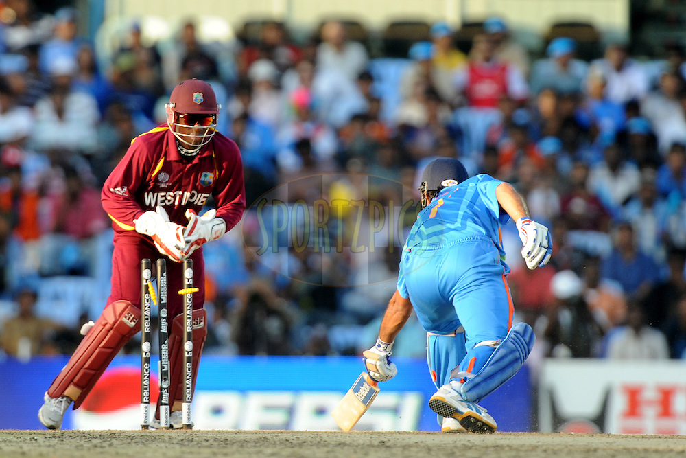 Mahendra Singh Dhoni captain of India gets stumped out by Devon Thomas of West Indies during the ICC Cricket World Cup match between India and The West Indies held at the MA Chidambaram Stadium in Chennai, Tamil Nadu, India on the 20 March 2011.Photo by Pal Pillai/BCCI/SPORTZPICS