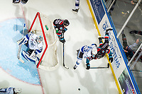 KELOWNA, CANADA - NOVEMBER 23:  Nolan Foote #29 of the Kelowna Rockets is checked by Parker Malchuk #23, behind the net of Griffen Outhouse #30 of the Victoria Royals  on November 23, 2018 at Prospera Place in Kelowna, British Columbia, Canada.  (Photo by Marissa Baecker/Shoot the Breeze)