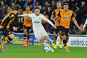 Matt Grimes  moves through the field during the Capital One Cup match between Hull City and Swansea City at the KC Stadium, Kingston upon Hull, England on 22 September 2015. Photo by Ian Lyall.