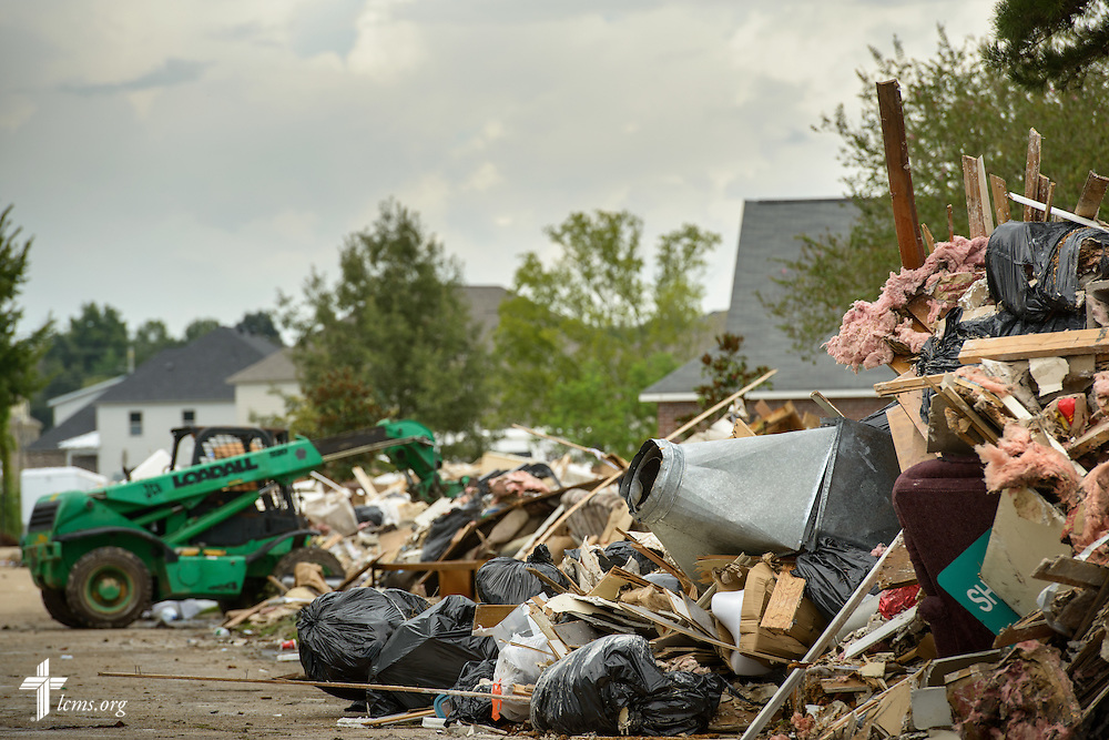 Debris is piled to the curb in a neighborhood following the aftermath of August flooding on Tuesday, Sept. 13, 2016, in Baton Rouge, La.,  LCMS Communications/Erik M. Lunsford