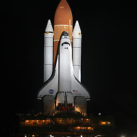 Space shuttle Endeavour moves slowly on it's journey from the Vehicle Assembly Building to launch pad 39A at the Kennedy Space Center in Cape Canaveral, Fla., on Thursday, March 10, 2011.  (AP Photo/Alex Menendez)