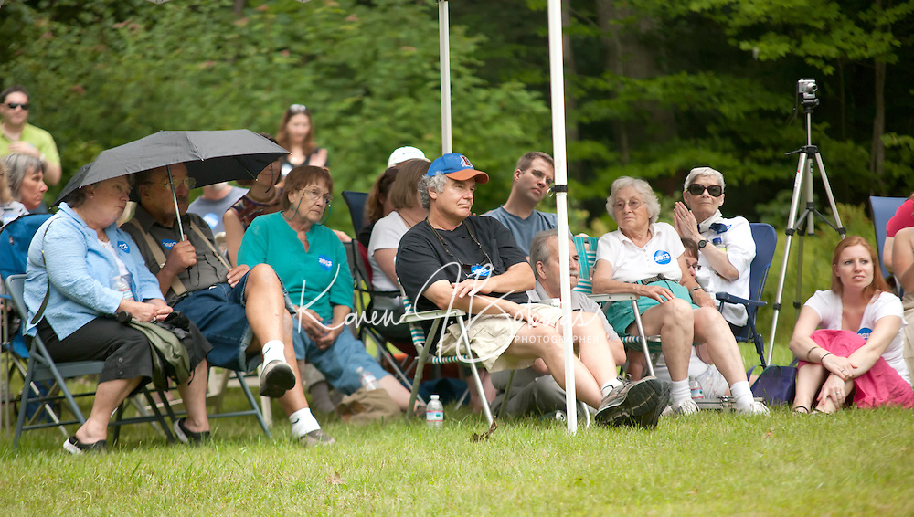 Supporters from the Merrimack County Democrats listen as Senator Bernie Sanders speaks during an informal BBQ in Canterbury Sunday afternoon.  (Karen Bobotas/for the Concord Monitor)Merrimack County Democrats backyard BBQ in Canterbury, NH  August 21, 2011.