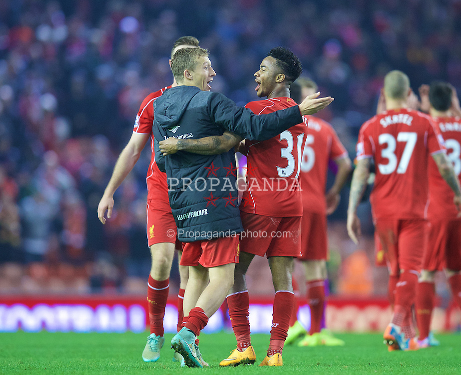 LIVERPOOL, ENGLAND - Saturday, November 29, 2014: Liverpool's Lucas Leiva and Raheem Sterling celebrate after the 1-0 victory over Stoke City during the Premier League match at Anfield. (Pic by David Rawcliffe/Propaganda)