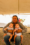 Henry Real Bird, Crow Elder, twin grandchildren, Crow Fair