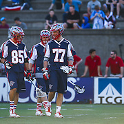 Kyle Sweeney #77 of the Boston Cannons and Mitch Belisle #85 of the Boston Cannons are seen during the game at Harvard Stadium on May 17, 2014 in Boston, Massachuttes. (Photo by Elan Kawesch)