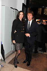 SIR PAUL McCARTNEY and his wife NANCY at a party to celebrate the switching on of the Christmas Lights at the Stella McCartney store, Bruton Street, London on 29th November 2011.