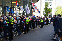 London, UK. 14 May, 2019. Supporters of Tommy Robinson wait outside the Old Bailey for the former English Defence League leader to appear following a hearing during which two High Court judges declared that fresh proceedings may be brought against him for an alleged contempt of court over the filming of people involved in a criminal trial.