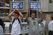Supporter hold placards during the speech of Journalist Shuntaro Torigoe, a major candidate for Tokyo. He kicks off his campaign for the July 31 Tokyo gubernatorial election in front of the station of Kita-Senju, Japan on Thursday, July 16 2016. <br /> Torigoe has the joint backing of opposition parties including the Democratic Party and the Japanese Communist Party in the July 31 election. 16/07/2016-TOKYO, JAPAN