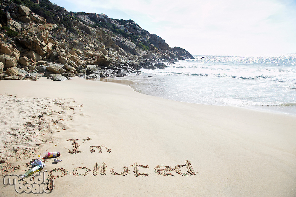 I'm polluted text written on beach elevated view