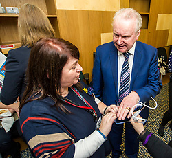 Pictured: Alex Neil MSP is shown how hard the mesh feels by Karen Neil<br /> Thousands of Scottish women have been fitted with polypropylene transvaginal mesh to treat pelvic organ prolapse or stress urinary incontinence. As a result women in every Scottish constituency have been severely injured or permanently disabled following this procedure, some have lost organs, many their careers and their relationships.&nbsp; The women and their families  are asking MSPs to sign a pledge <br /> <br /> Ger Harley | EEm 16 March 2017