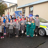 All the prize winners pictured with members of the Garda Síochána receiving their prizes in  the Garda Crime Prevention Art Competition