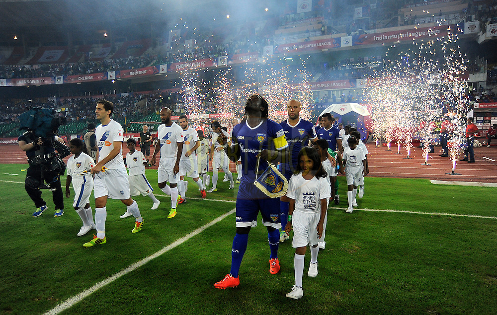 Players walk to the field of play before the start of match 15 of the Hero Indian Super League between Chennaiyin FC and Mumbai City FC held at the Jawaharlal Nehru Stadium, Chennai, India on the 28th October 2014.<br /> <br /> Photo by:  Pal Pillai/ ISL/ SPORTZPICS