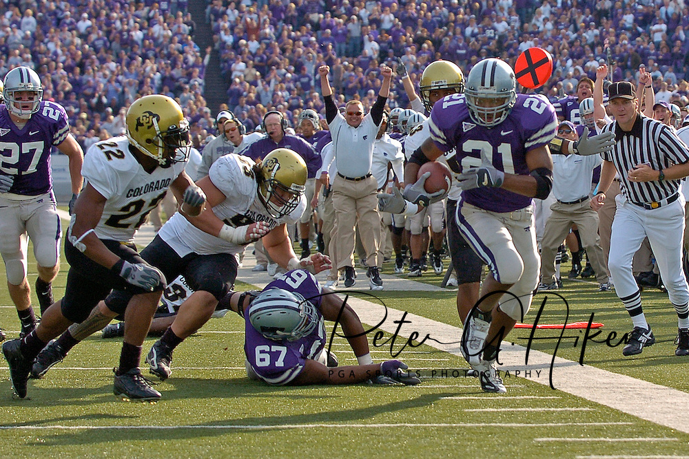 Kansas State running back Carlos Alsup (21) races down the sideline, as Colorado linebacker Byron Ellis (22) comes in form the side in the third quarter at KSU Stadium in Manhattan, Kansas, October 29, 2005.  The Buffaloes beat K-State 23-20.