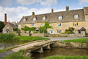 Lower Slaughter Mill and popular tourist attraction village in The Cotswolds, Gloucestershire, England, UK