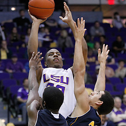 December 15, 2011; Baton Rouge, LA; LSU Tigers guard Ralston Turner (22) shoots over UC Irvine Anteaters guard Chris McNealy (5) and guard Daman Starring (22) during the second half of a game at the Pete Maravich Assembly Center. LSU defeated UC Irvine 66-59.  Mandatory Credit: Derick E. Hingle-US PRESSWIRE