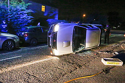 Pictured: A car lies on its side following a crash on Moray Drive Linlithgow around 11.00pm on the 28th Septermber, The driver of the pick up had hit 3 parked cars before flipping, He was helped from the vehicle before attempting to flee the scene but was chased and detained by locals until the police arrived.  Andrew West/ EEm