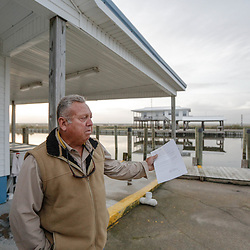 Terry Serigny of Terry's Live Bait a small business that caters to fisherman has seen his business hurt from the construction of a elevated highway that bypasses his business in Leeville, Louisiana, U.S., on Monday, December 18, 2017.  Louisiana is preparing recommendations through projects with LA Safe for emptying out coastal areas that are unprotected by levees and will be impacted by sea level rise in the coming years. Photographer: Derick E. Hingle/Bloomberg