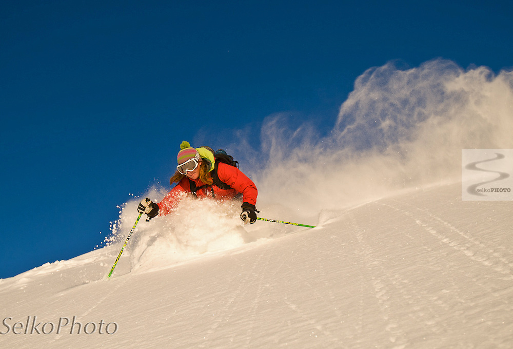 Crystal Wright on a blue sky powder skiing morning on Teton Pass on April 7, 2010.