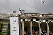 Dougie Lampkin riding motorbike on roof, The Cartier Style et Luxe Concours lunch at the Goodwood Festival of Speed. July 13, 2008  *** Local Caption *** -DO NOT ARCHIVE-© Copyright Photograph by Dafydd Jones. 248 Clapham Rd. London SW9 0PZ. Tel 0207 820 0771. www.dafjones.com.