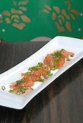 Smoked salmon garnished with spring onions