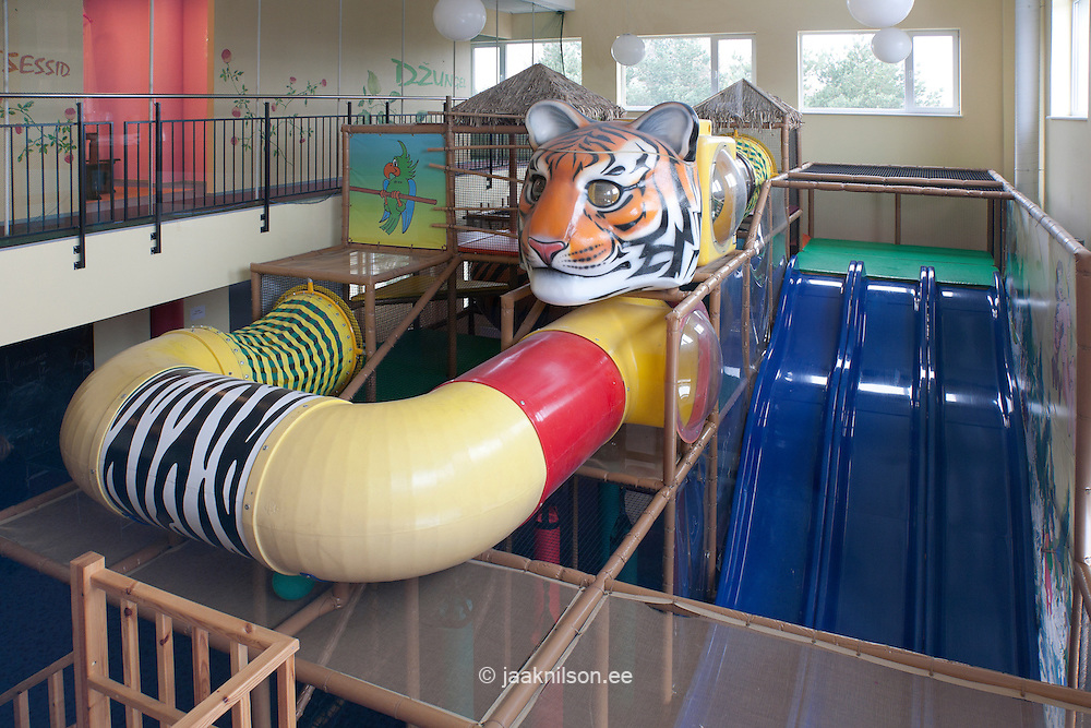 Indoor kids playground with climbing frame, slope and tube slide, Viimsi spa hotel in Tallinn, Estonia