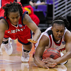22 March 2009:  Louisville guard Deseree' Byrd (50) dives for a loose ball with Liberty guard Amber Mays (21) during a NCAA Women's Division I Championship first round game between third-seeded Louisville and 14th-seeded Liberty at the Pete Maravich Assembly Center in Baton Rouge, LA.