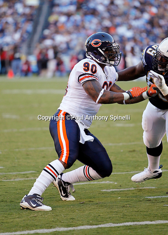 Chicago Bears defensive end Julius Peppers (90) tries to work his way around a block by San Diego Chargers guard Tyronne Green (69) during a NFL week 1 preseason football game against the San Diego Chargers, Saturday, August 14, 2010 in San Diego, California. The Chargers won the game 25-10. (©Paul Anthony Spinelli)