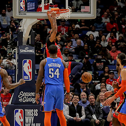 Dec 12, 2018; New Orleans, LA, USA; New Orleans Pelicans forward Anthony Davis (23) dunks over Oklahoma City Thunder forward Paul George (13) and forward Patrick Patterson (54) during the second quarter at the Smoothie King Center. Mandatory Credit: Derick E. Hingle-USA TODAY Sports