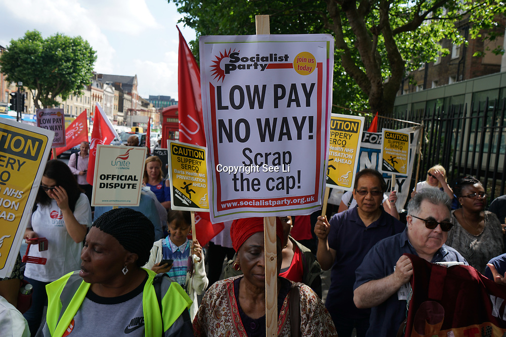 London, England, UK. 4th July 2017. Hundreds march and rally from St Barts' Trust Strike to Support the Cleaners, Porters and Security protest to Scrap the Cap protest, Low Pay, No Way at The Royal London Hospital organise by Unite the Union.