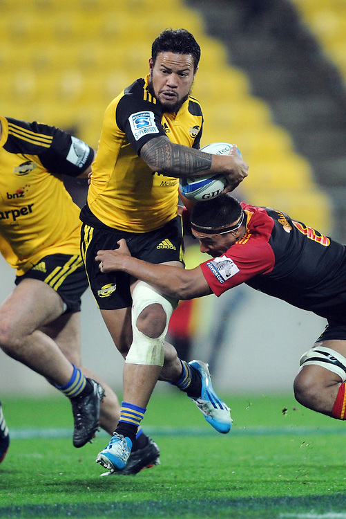 Hurricanes' Alapati Leiua runs through the tackle of Chiefs' Tanerau Latimer in the Super Rugby match at Westpac Stadium, Wellington, New Zealand, Saturday, May 24, 2014. Credit:SNPA / Ross Setford